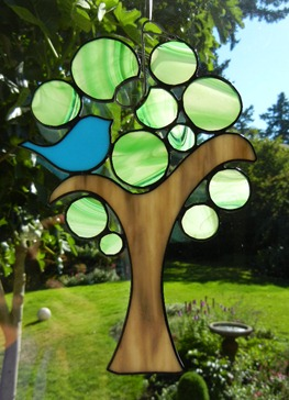 Stained Glass Song Bird in Green Tree Design